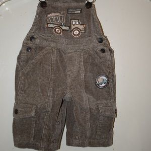 Corduroy brown overalls with construction trucks